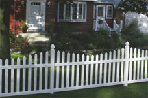 Danbury Concave Vinyl Fence by a Brick House